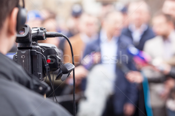 Filming an event with a video camera. Press conference. Stock photo © wellphoto