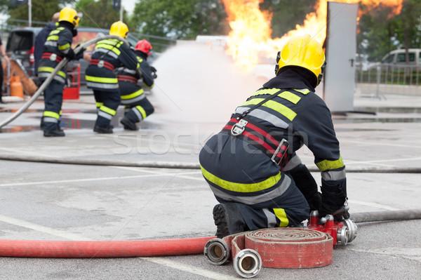 Tűzoltóság képzés tűzoltók víz tűz harcol Stock fotó © wellphoto
