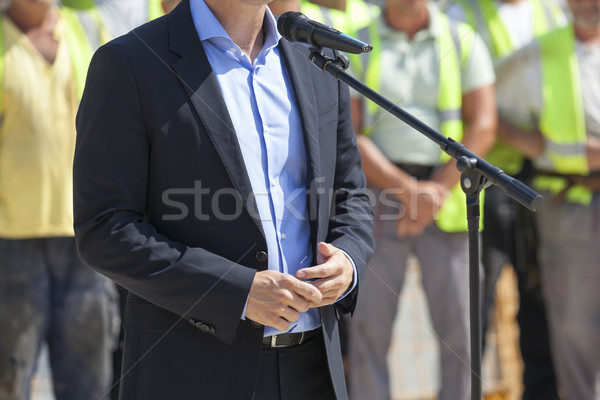 Politician or businessman is giving a speech Stock photo © wellphoto