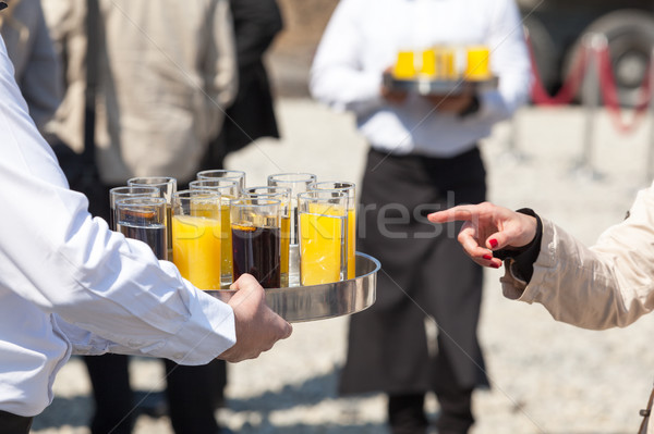 Waiter serving soft drinks at a party Stock photo © wellphoto