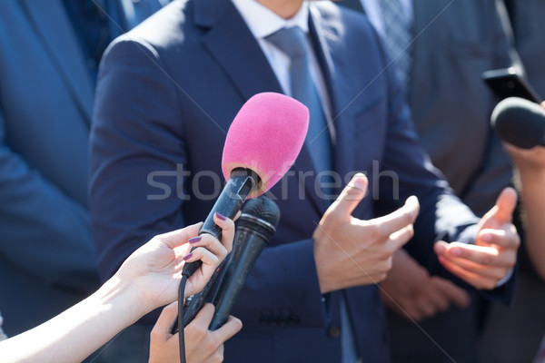 Media interview. Hand gesture. Business person or politician. Stock photo © wellphoto