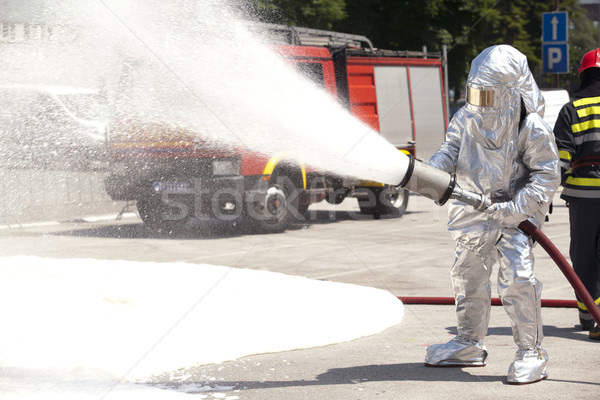 Stock photo: Firefighter in action