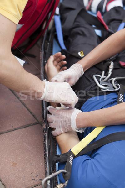 Premiers soins bandage blessés main infirmière Photo stock © wellphoto