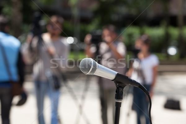 Microphone in focus against blurred cameraman Stock photo © wellphoto