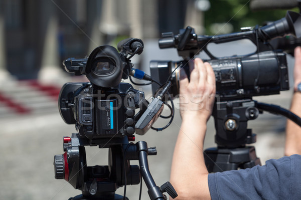 Filming an event with a video camera Stock photo © wellphoto