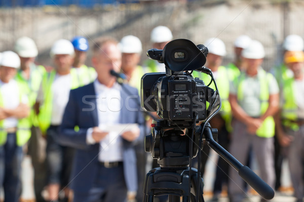 Stock photo: Filming an event with a video camera