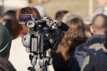 Filming street protest using video camera Stock photo © wellphoto