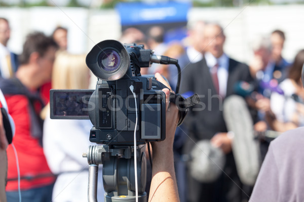 Filming press conference with a video camera Stock photo © wellphoto