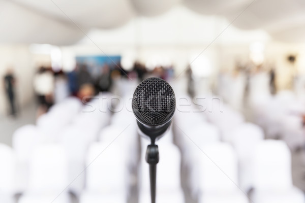 Microphone in focus, empty conference room in the background Stock photo © wellphoto