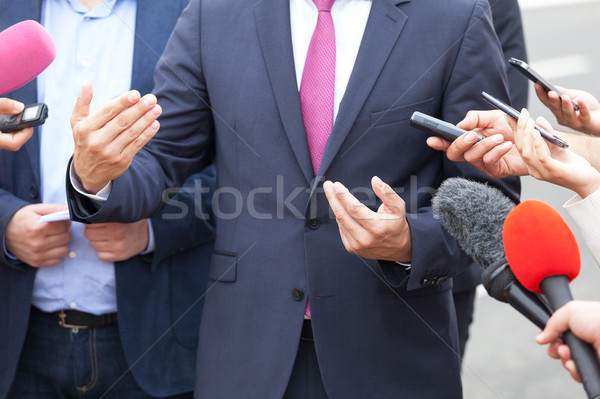 Press interview. Hand gesture. Businessman or politician. Stock photo © wellphoto
