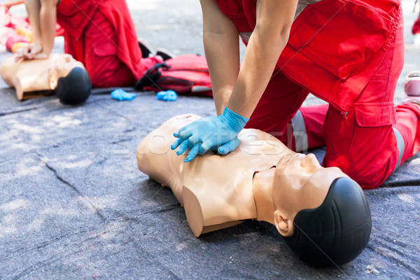 CPR. First aid training concept. Cardiac massage. Stock photo © wellphoto