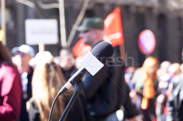 Political protest. Demonstration. Microphone in focus, blurred p Stock photo © wellphoto