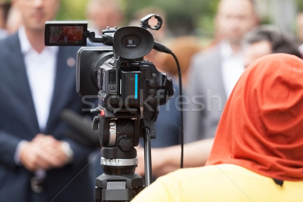 Press conference. Video camera. Stock photo © wellphoto