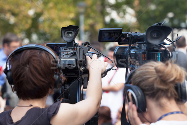 News conference. Filming an event with a video camera. Stock photo © wellphoto