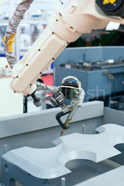 Endüstriyel kaynak robot kol Metal Stok fotoğraf © wellphoto