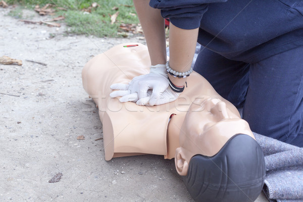 Paramedic demonstrates CPR on a dummy Stock photo © wellphoto