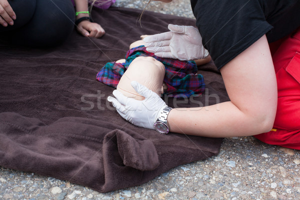 Infant dummy first aid. CPR. Stock photo © wellphoto