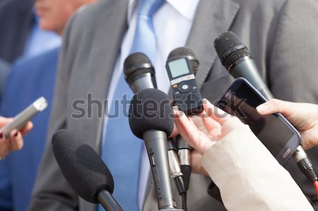 Stock photo: Reporter making interview