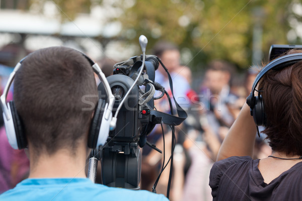 News conference. Cameraman. Video camera. Stock photo © wellphoto