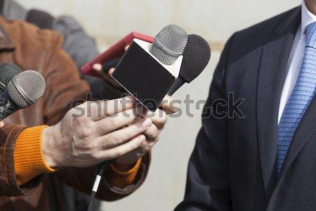 Interview microfoon spreker presentatie televisie Stockfoto © wellphoto