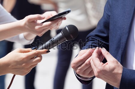 Stock photo: Reporters making interview with businessperson, politician or spokesperson.
