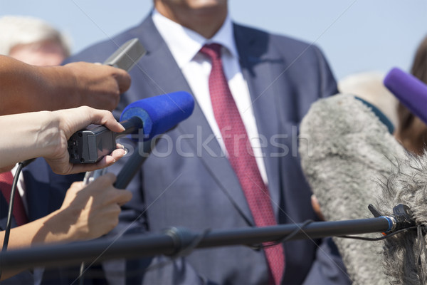 Media interview with businessperson, politician or spokesman Stock photo © wellphoto
