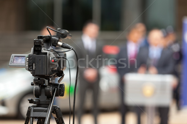 Stock photo: Press conference. Covering an event with a video camera.