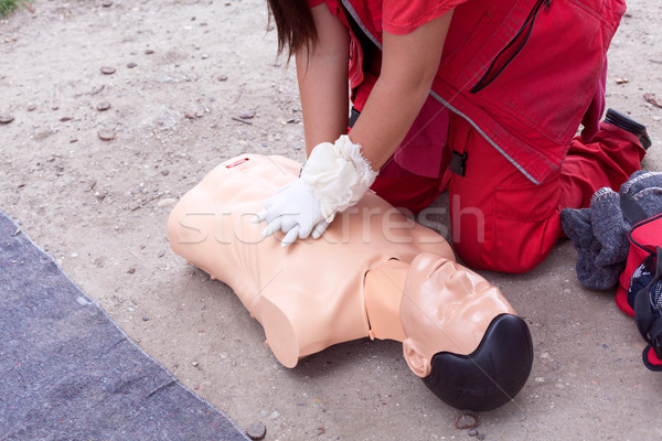 Female paramedic showing cardiopulmonary resuscitation - CPR on training doll. Stock photo © wellphoto