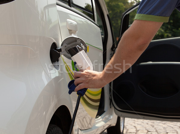 Stockfoto: Elektrische · auto · hand · natuur · groene · macht · verontreiniging