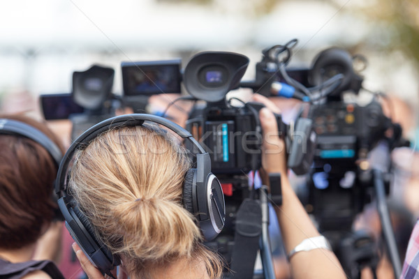 Stock photo: News conference. Filming an event with a video camera.