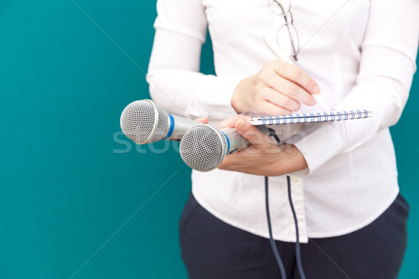 Female reporter or journalist at press conference, writing notes Stock photo © wellphoto
