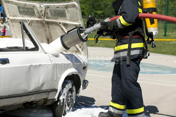 Brandweerman opleiding actie auto brand dienst Stockfoto © wellphoto
