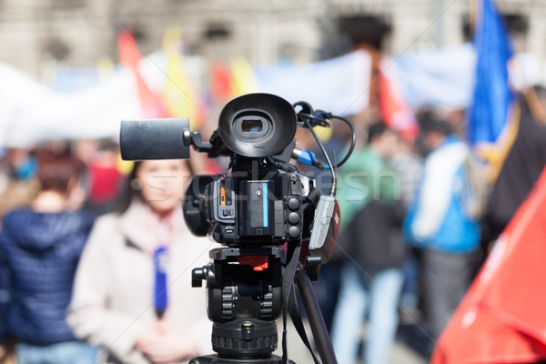 Stock photo: Filming street protest using a video camera
