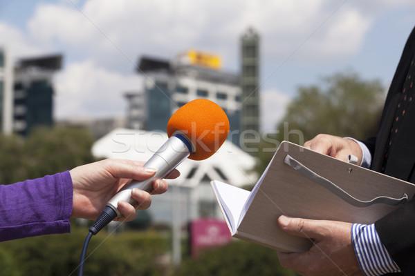 Druk interview media business televisie microfoon Stockfoto © wellphoto