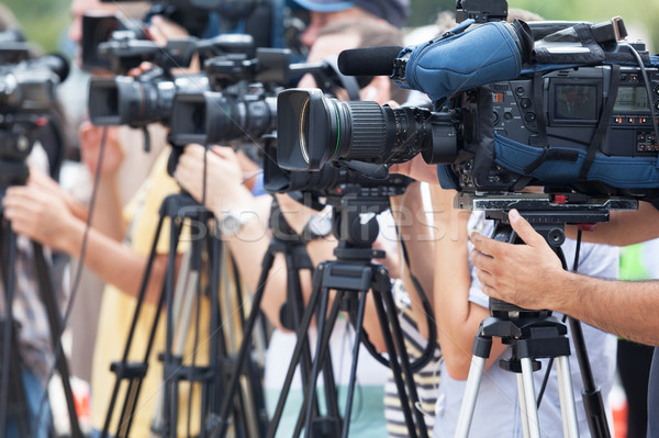 Video camera operators working at press conference Stock photo © wellphoto