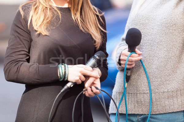 Female journalists holding microphones waiting for press confere Stock photo © wellphoto