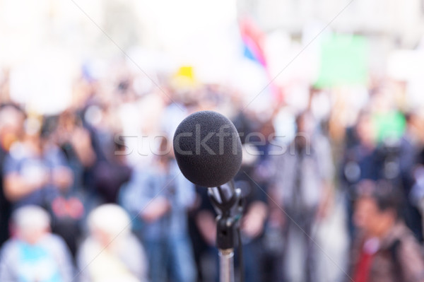 Microphone in focus, against blurred crowd Stock photo © wellphoto