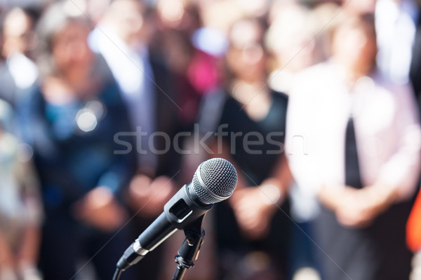 Microphone in focus against blurred audience Stock photo © wellphoto