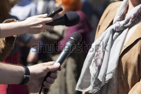 Stock photo: Media interview. Broadcast journalism. News conference. Microphones.