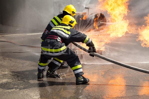 Tűzoltók tevékenység tűzoltóság képzés támadás tűz Stock fotó © wellphoto
