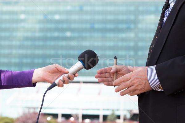 Journalist interviewing businessperson, corporate building in ba Stock photo © wellphoto