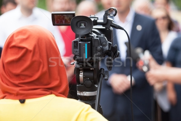 Camerawoman. News conference.  Stock photo © wellphoto