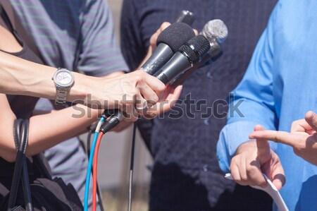 Medya görüşme gazeteci mikrofon el Stok fotoğraf © wellphoto