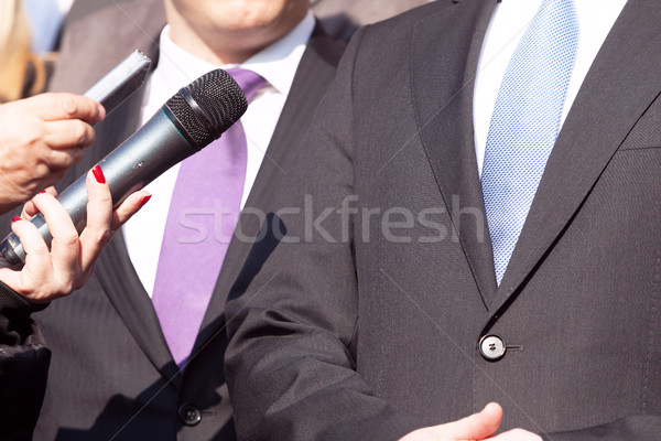 Media interview with businessman or politician Stock photo © wellphoto