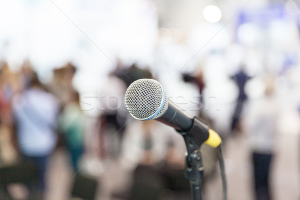Microphone in focus against blurred audience. Press conference. Stock photo © wellphoto