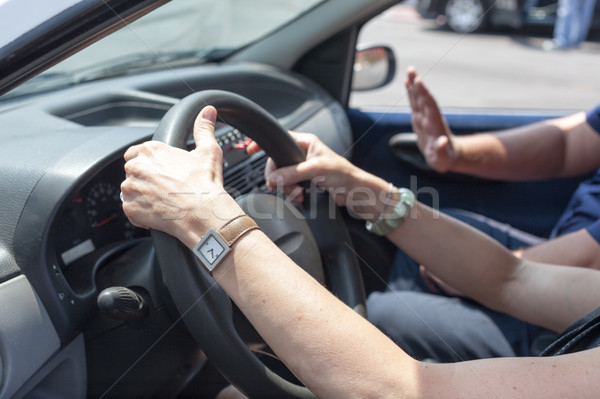 Senior learning to drive a car with a driving instructor Stock photo © wellphoto