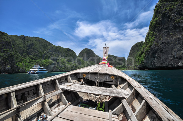 Traditional wooden boats in a picture perfect tropical Maya bay Stock photo © weltreisendertj