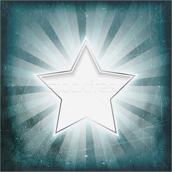 Silver rimmed star on aged light rays parchment Stock photo © wenani