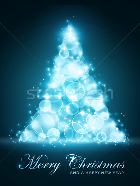 Blue glowing Christmas tree made of out of focus light dots Stock photo © wenani