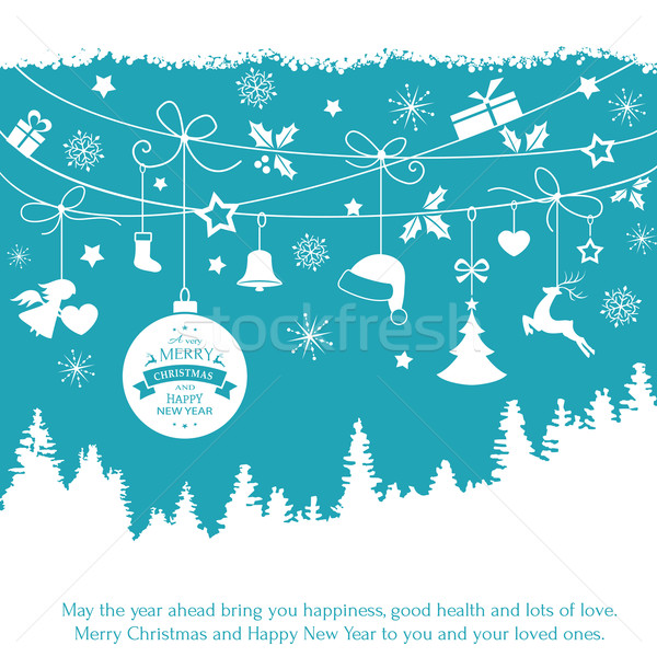 Blue card with hanging Christmas ornaments over fir tree landsca Stock photo © wenani